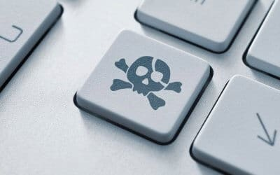 Keyboard with several keys showing and one of them having a cross and skull indicating a vulnerability
